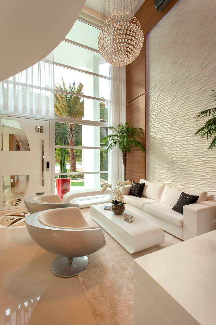 Casa Vanessa: Salas de estar por Designer de Interiores e Paisagista Iara Kílaris