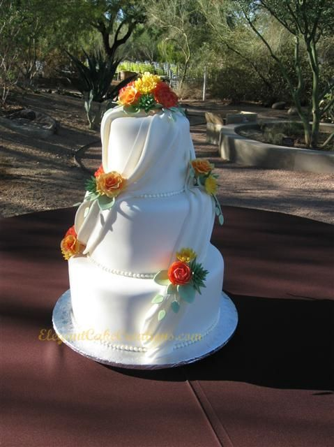 Swags And posies, a favourite combination, love the bright orange and yellow complimented by the soft green - by elegant Cake Creations : http://www.elegantcakecreations.com/Pages/WeddingCakes.aspx#