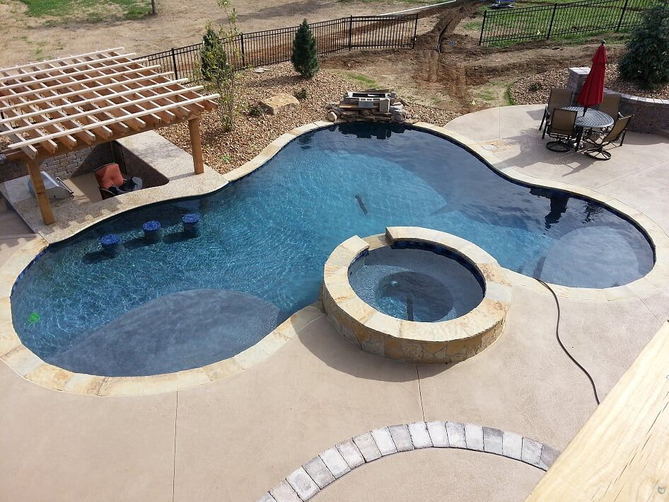 Blue Haven Pools Of Kansas City Custom Free Form Gunite Concrete Pool With Swim Up Bar And