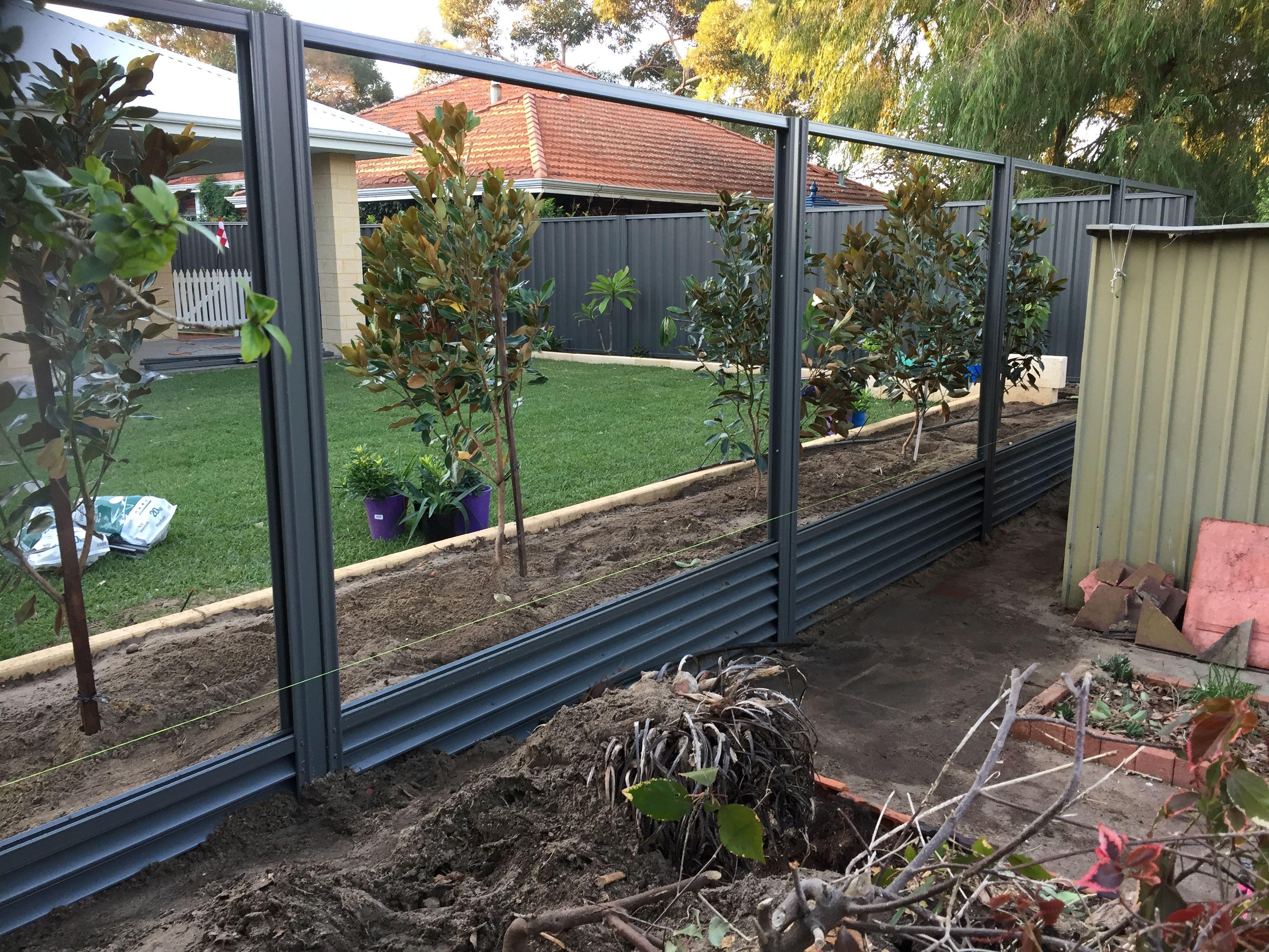 colorbond steel fencing install using gramline plinths underneath