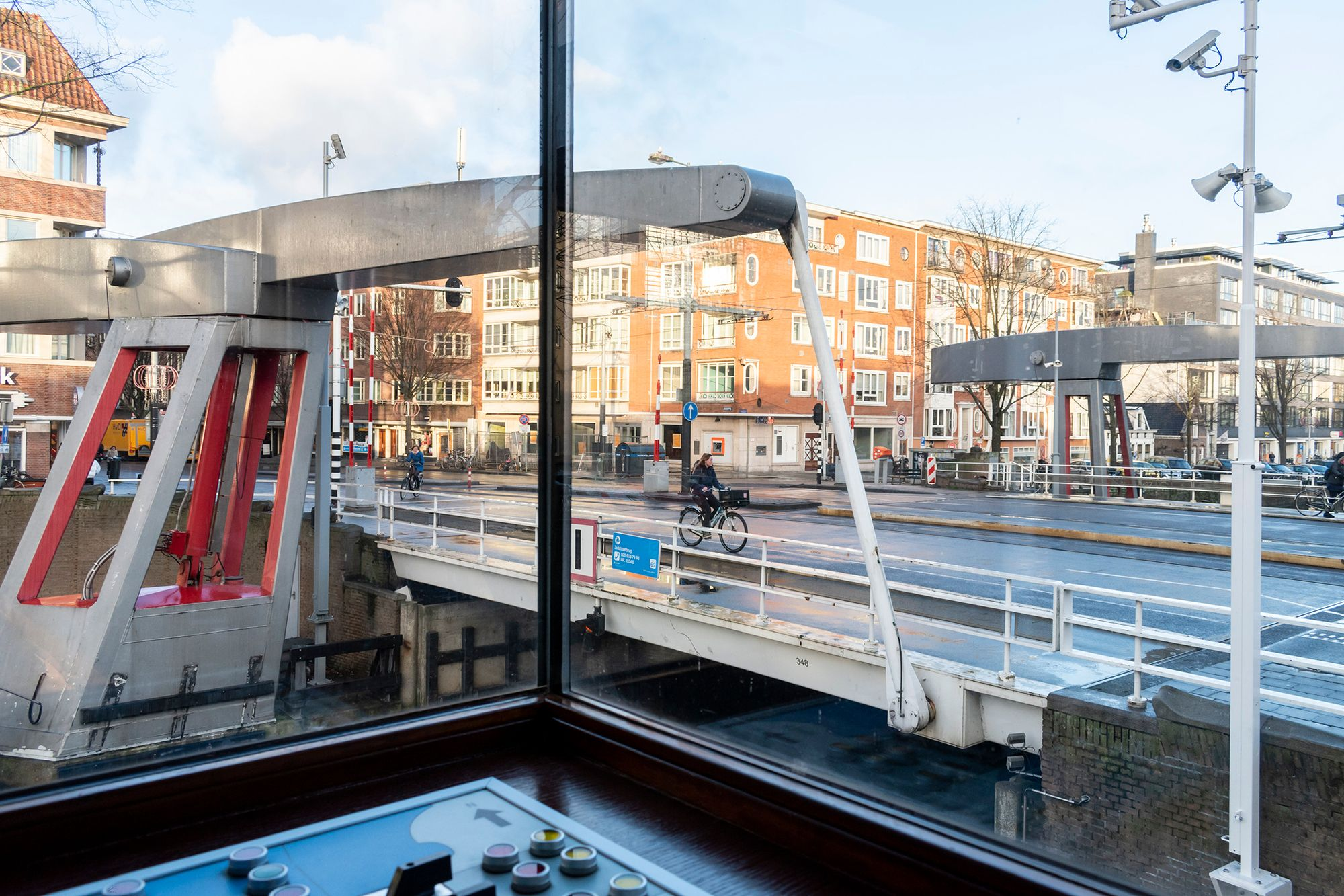 Bridgekeeper for a day at SWEETS hotel's bridge house 311 - Zeilstraatbrug.    ________ #sweetshotel #amsterdam #hotel #hotels #unique #unusual #zeilbrug #zeilstraat #zeilstraatbrug #amsterdamwest #brugwachter #bridgekeeper #bridgekeepershouse #brugwachtershuisje #cyclist #bridge #bridgehouse #bridgehousehotel #roomwithaview #dispersed #hotels #deconstructed #hotels #experiencehotels #wanderlust #travel