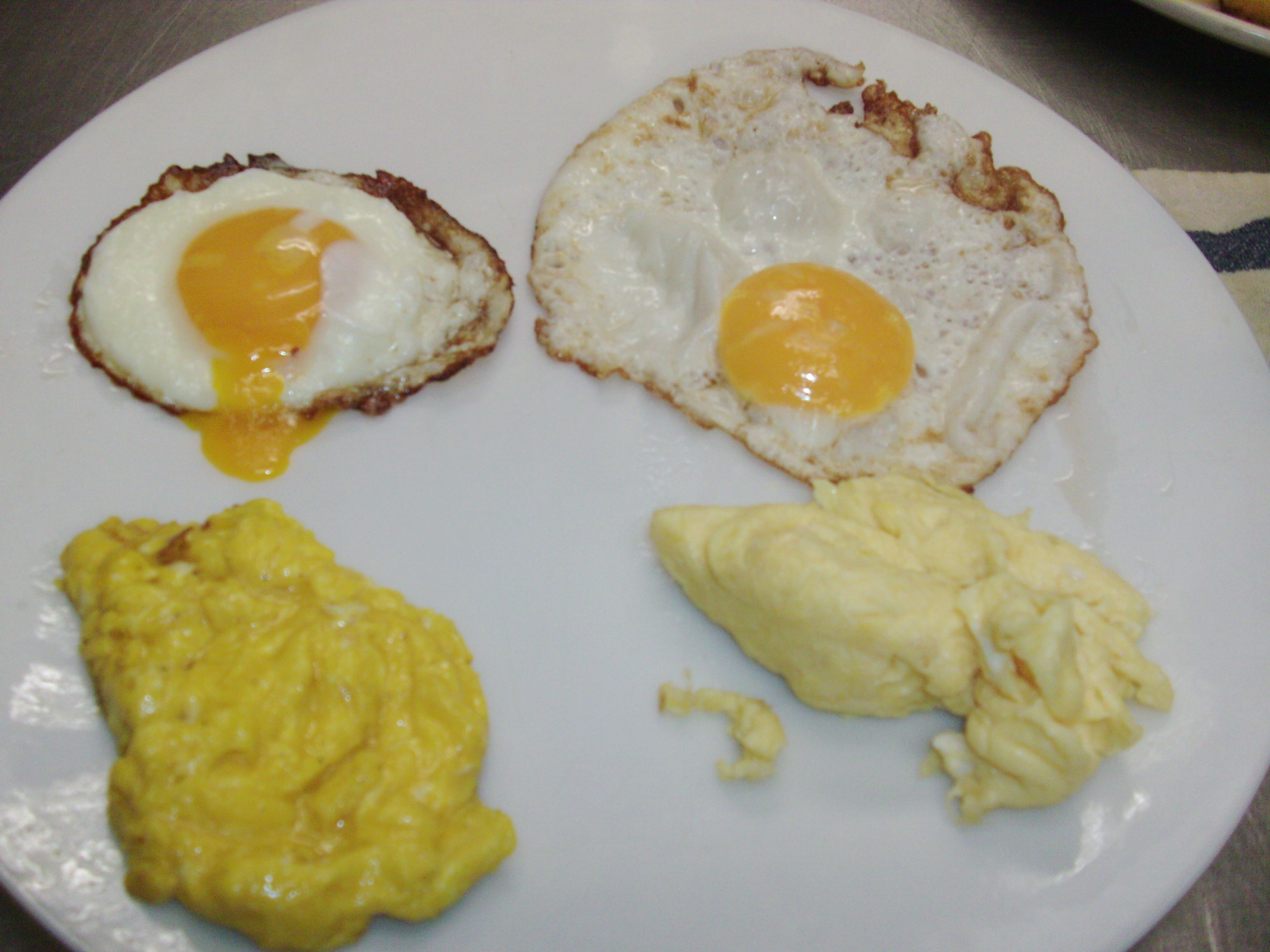 "Home grown (from very spoiled chickens) on the left, commercial ""natural"" eggs on the right."