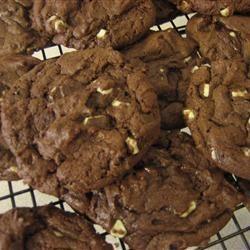 Cake Mix, 1/2 butter, 2 eggs, 3 tbs. flour, semi-sweet chocolate chips, 1 tsp vanilla. 350, 12 minutes