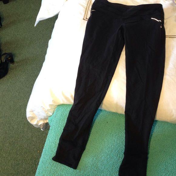 Athleta Mid Length Spandex Black With A Zipper Pocket In