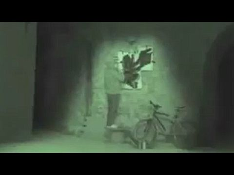 The famous Banksy spotted? CCTV captures street artist using stencil on ...
