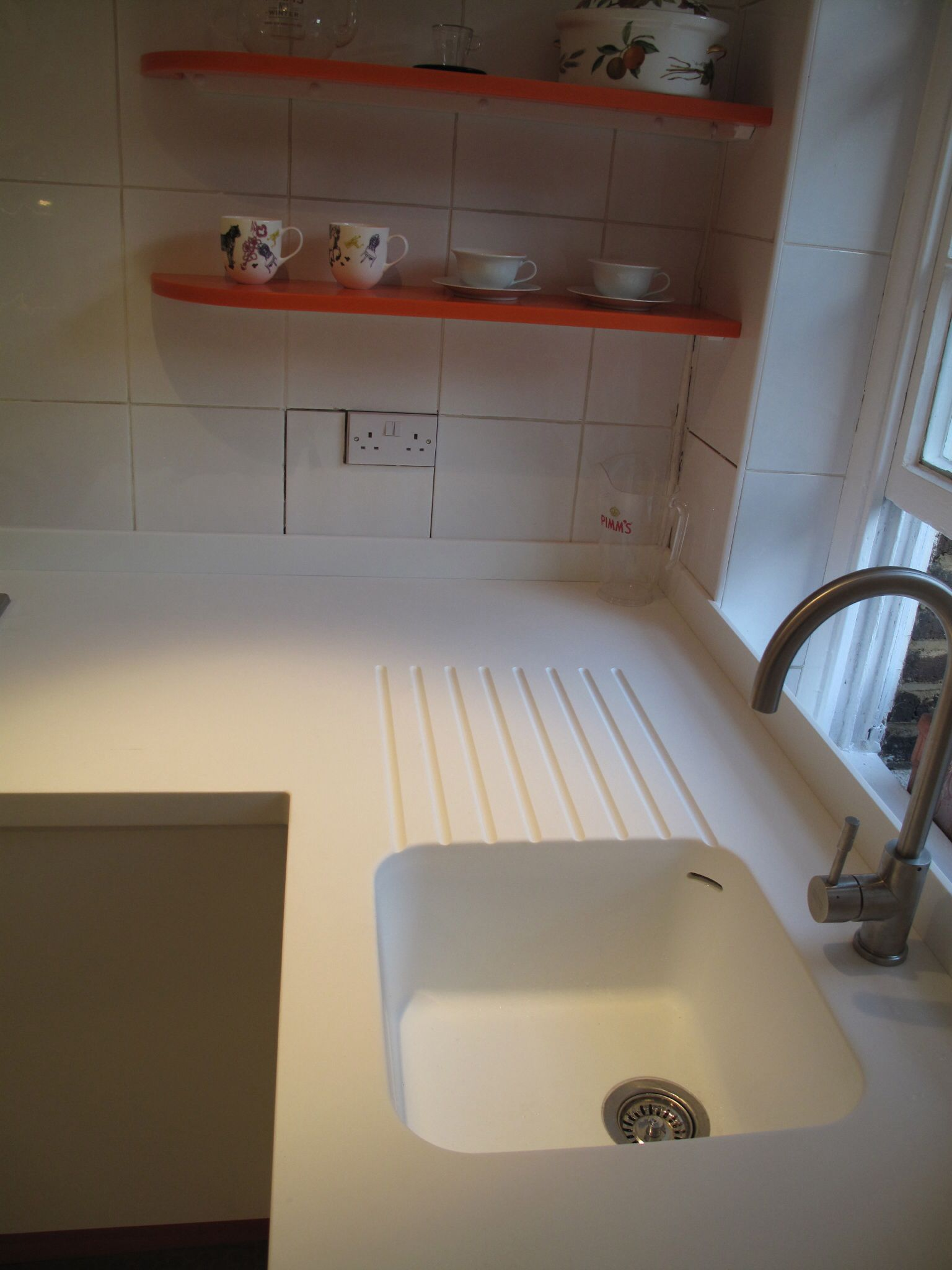 Seamless Corian Sink And Worktop With Routed Drainer Grooves Corian Countertops Countertops Sink