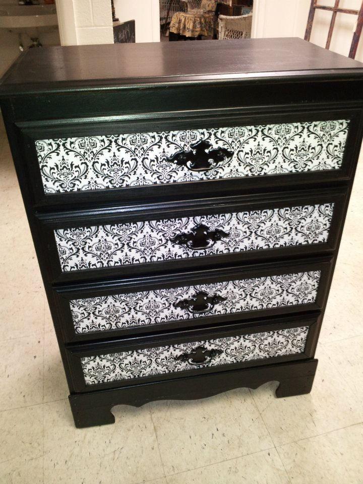 Re-purposed dresser! The damask is scrap book paper.
