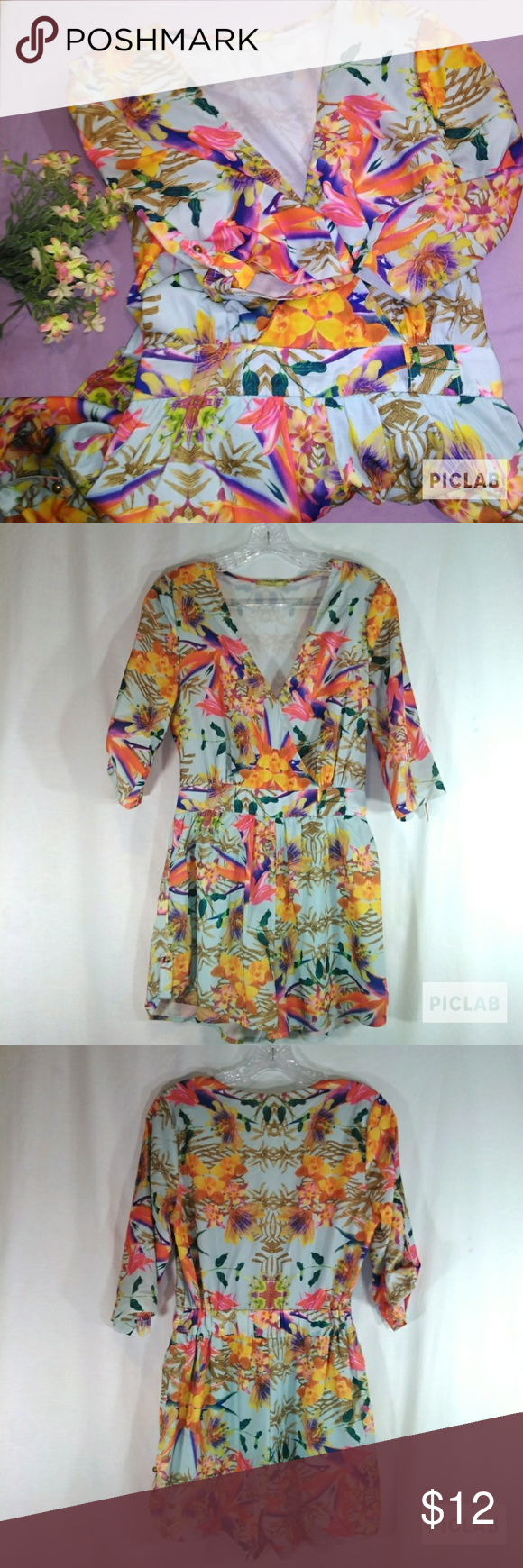 a196d94b768 Gianni Bini floral romper X-small Gianni Bini tropical floral romper. Size  extra small. 1 2 sleeve. Missing button