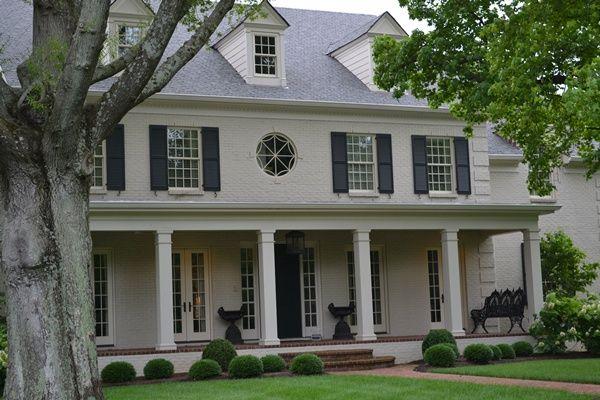 Perfect grey/ivory/bone painted brick house.