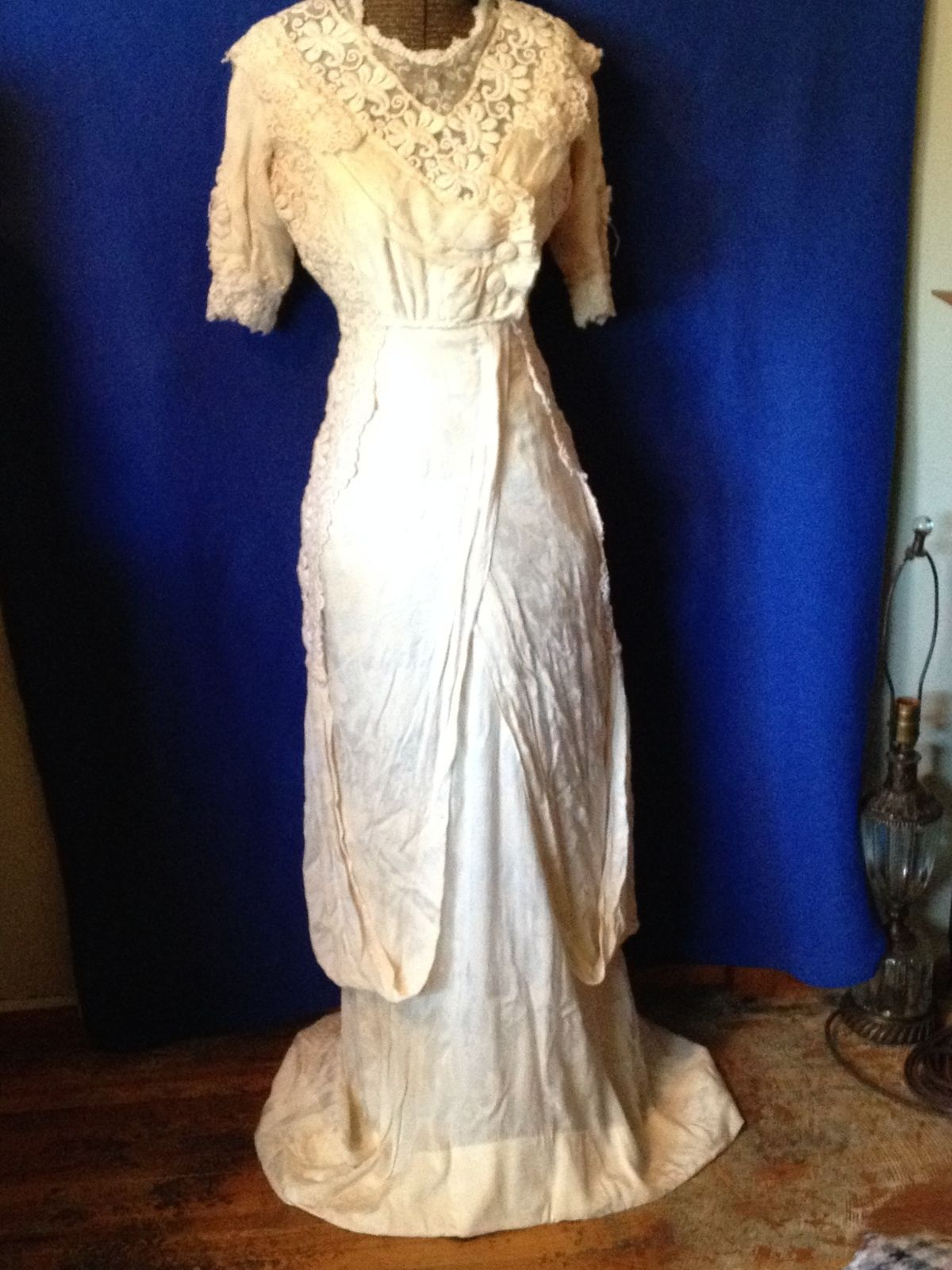 An edwardian wedding dress with irish lace such as travelers would