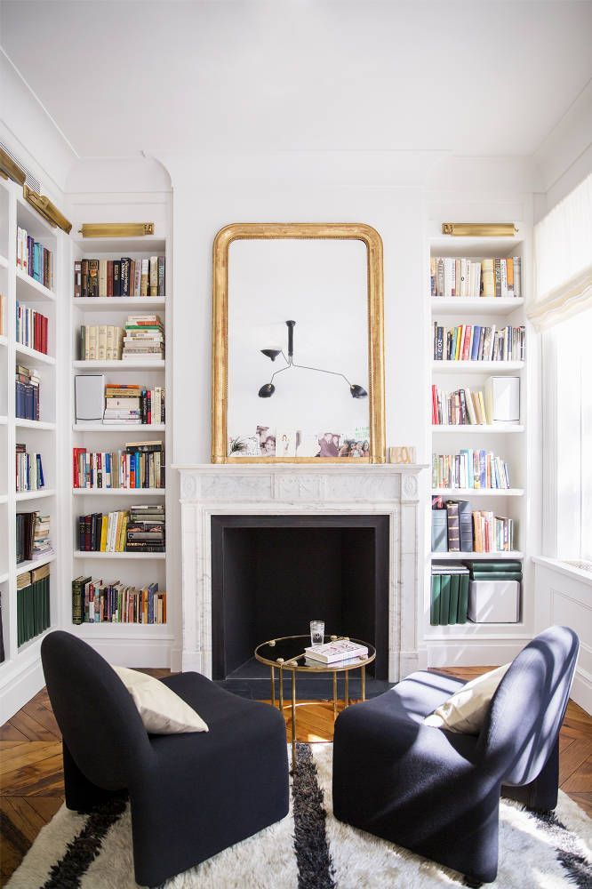Built Ins Around Room Perimeter, White Walls, White Bookcases, Fireplace,  Large Gold