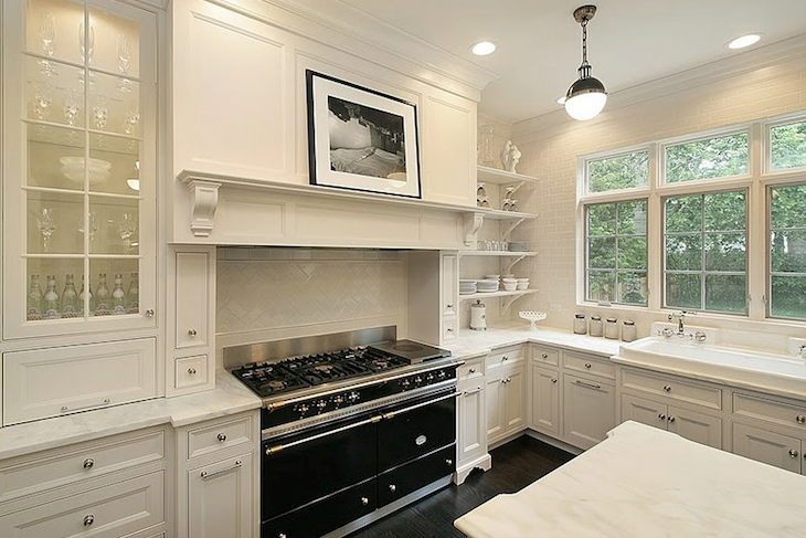 Dream kitchen with creamy white glass-front kitchen cabinets ...