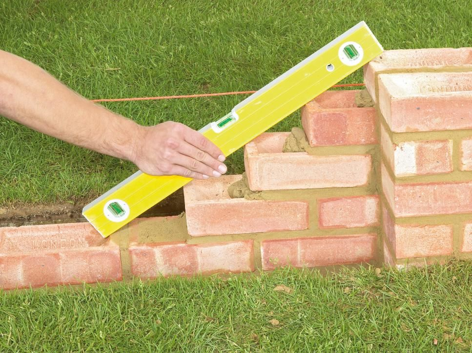 How to Build a Brick Garden Wall | Retaining walls, Walkways and Bricks