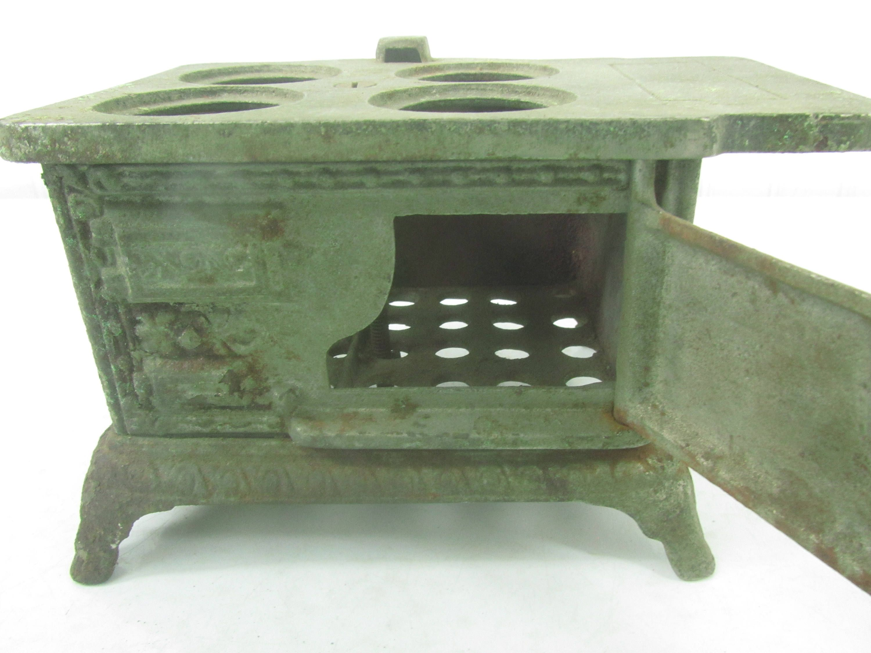 pressed metal furniture. Metal Toy Stove, Eagle Cast Iron Oven, Small Collectible Pressed Furniture .