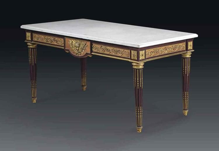 A FRENCH ORMOLU-MOUNTED MAHOGANY AND PLANEWOOD CENTRE TABLE