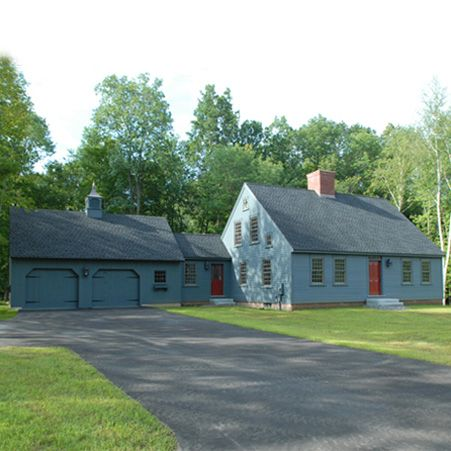 Exterior of Cape House with Center Chimney and Carriage House ...