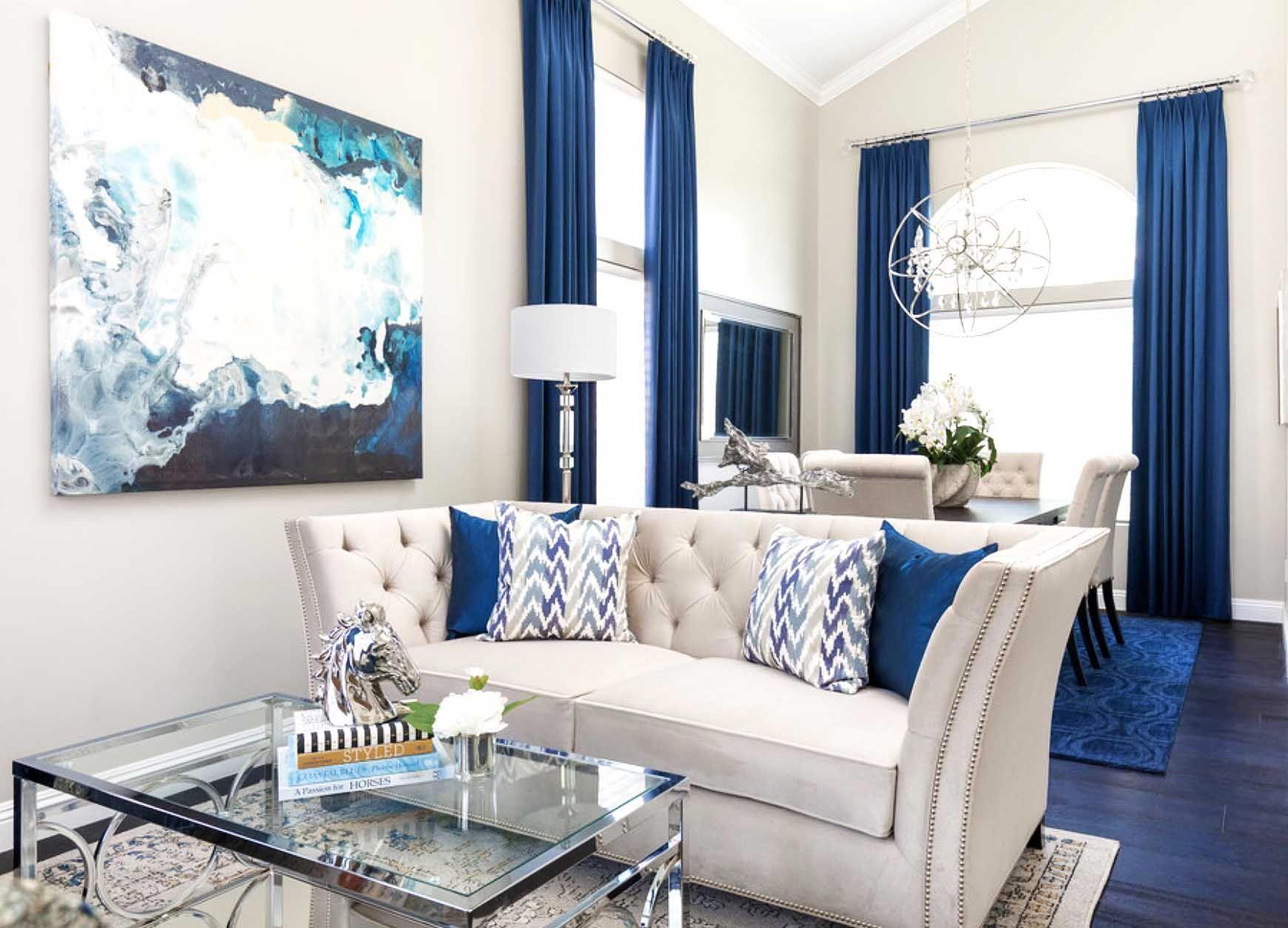 Gorgeous Blue And White Glam Living Room Decor With Elegant White Velvet Tufted Sofa Modern Gla Glam Living Room Glam Living Room Decor Blue Living Room Decor