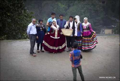Iranian family in Masouleh wearing traditional clothing.