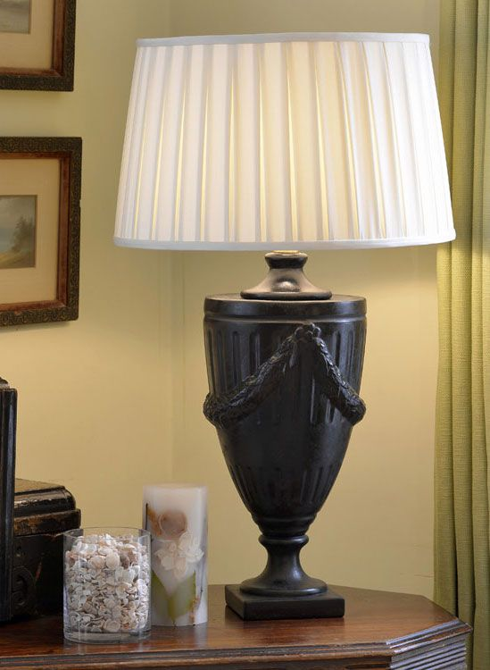 Elegant interior setting featuring italian ceramic lamp with classic urn motif classic home lighting ideas