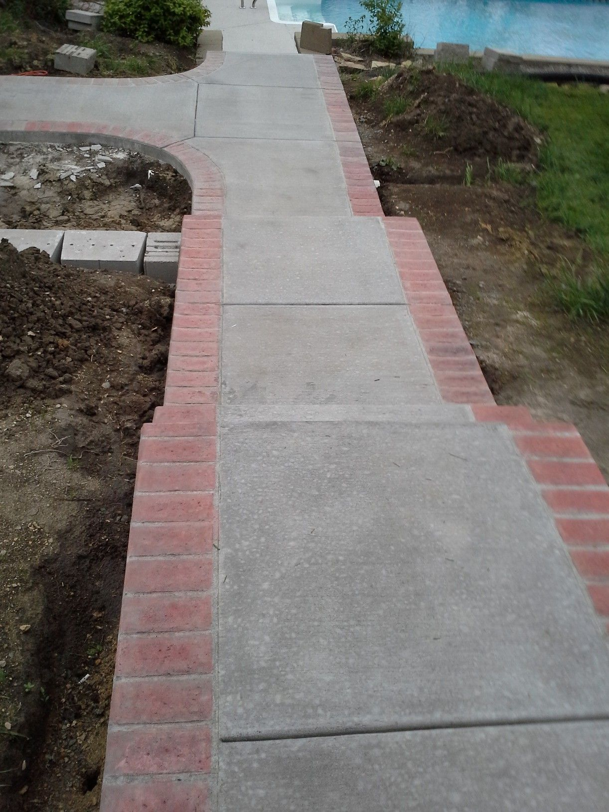 Concrete sidewalk with stamp brick border stain was for Brick sidewalk edging