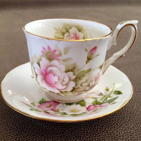 Vintage demitasse Teacup and Saucer by Duchess - pattern Martine. Bone china made in England! Pink and white flowers. Collectable!