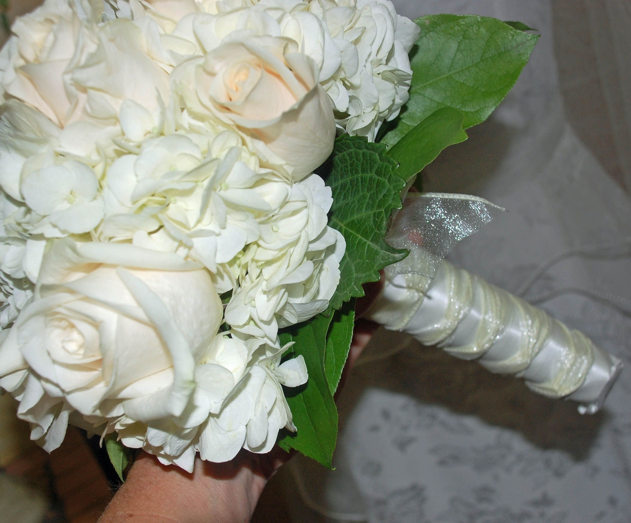 Sheer ribbon and satin wrap detail, brides wedding bouquet ...