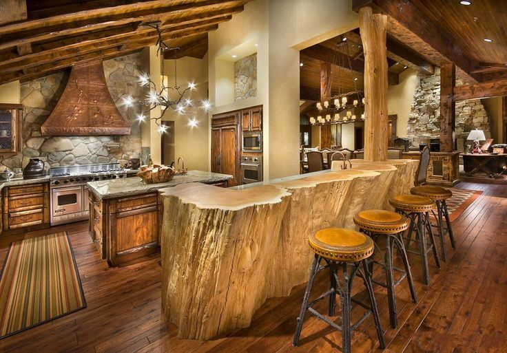 Rustic cabin kitchen design with log wood bar table and Log cabin chandelier