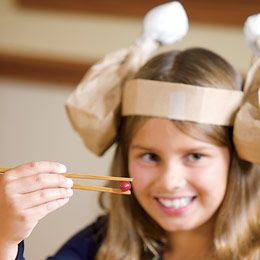 Look for something fun to do indoors. Try Chopstick Pass-Along