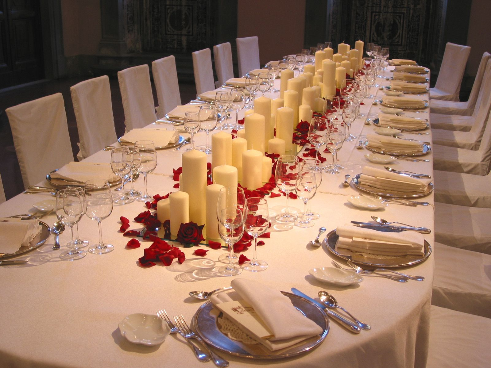 Candles, mirrors and red rose petals.