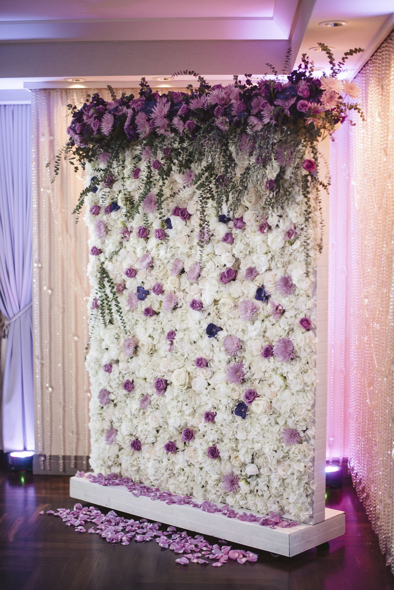 Floriculture S White Lavender Flower Wall With Large Cascading Arrangements Accented A White Flower Arrangements Pink Flower Arrangements Flower Wall Wedding