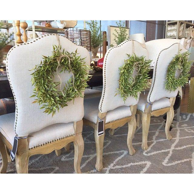 Alice Lane Home Collection Linen Dining Chairs Wreath On Back Of Chair Gray Rug Holiday Decor Christmas Christmas Decor Inspiration White Christmas Decor