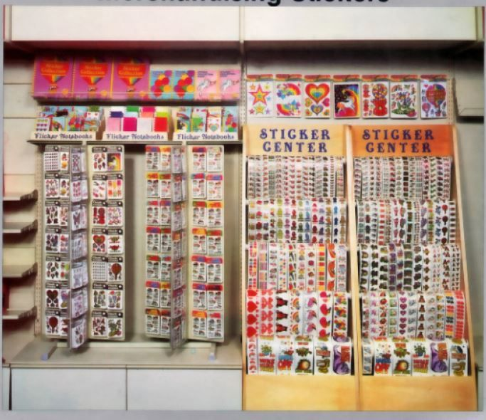 Display full of vintage 80s sticker albums and sticker rolls as well as packaged stickers made