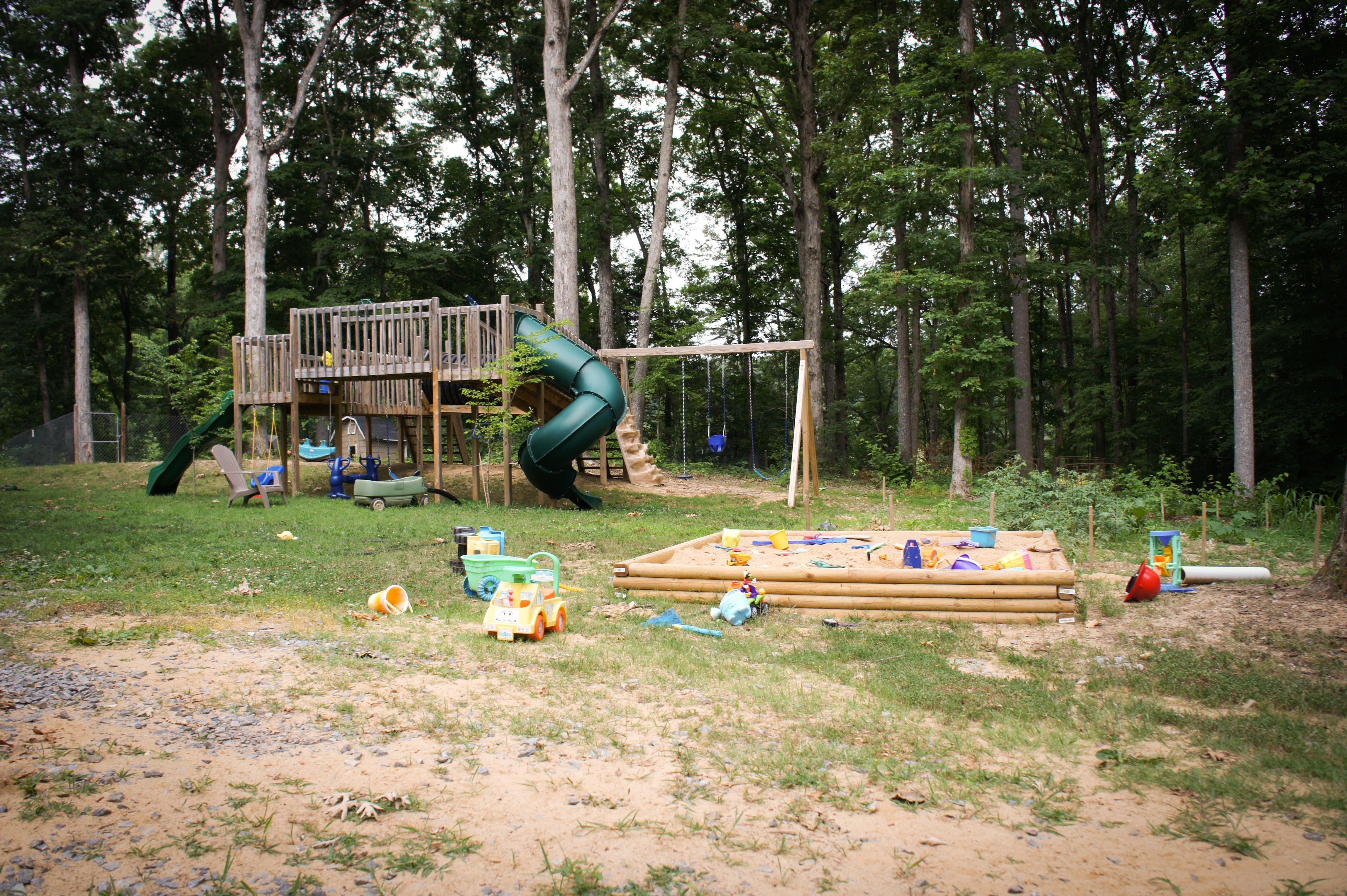 backyard playground ideas with wood bridge and wavy shape slide at