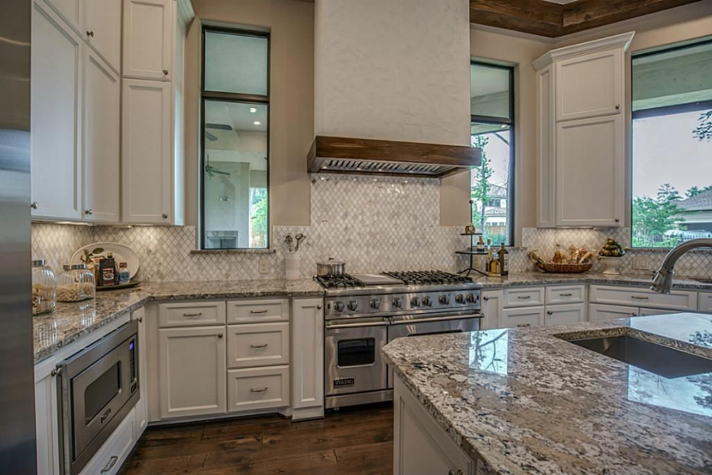 Gourmet Kitchen Shines With Linen Colored Cabinets And Blanco Antico Granite Counters