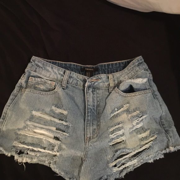 Jean ripped shorts Worn a couple times . Jean light wash denim shorts . Forever 21 Shorts Jean Shorts