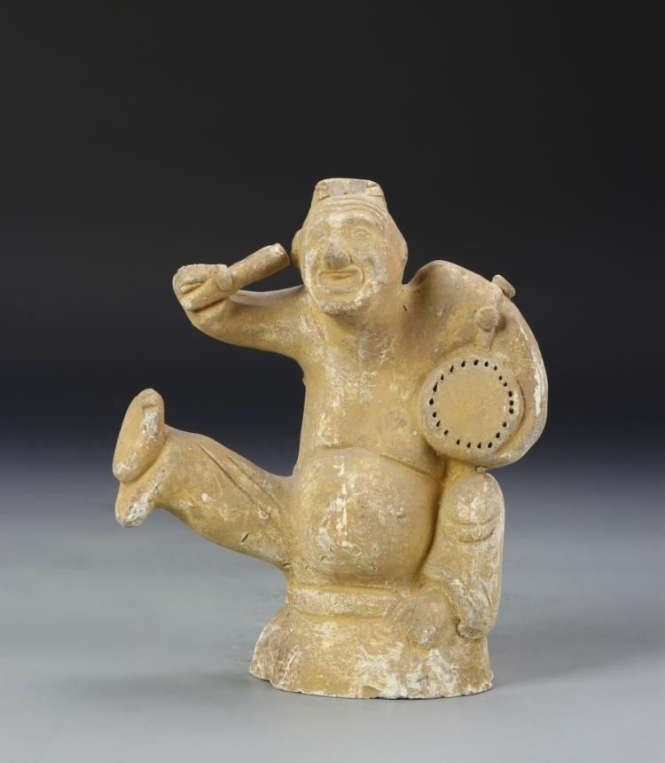 Description: China, Tang Dynasty, antique pottery male figure standing holding a…