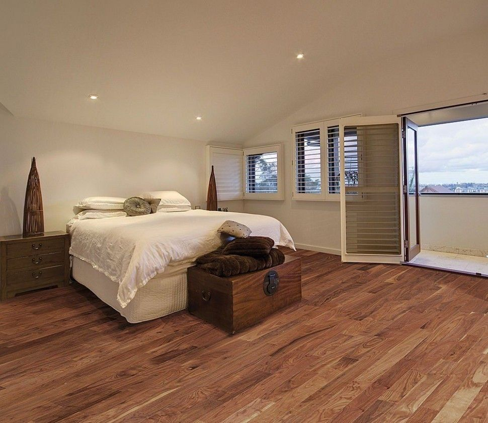 Bedroom Laminate Flooring Ideas An breadth rug provides a