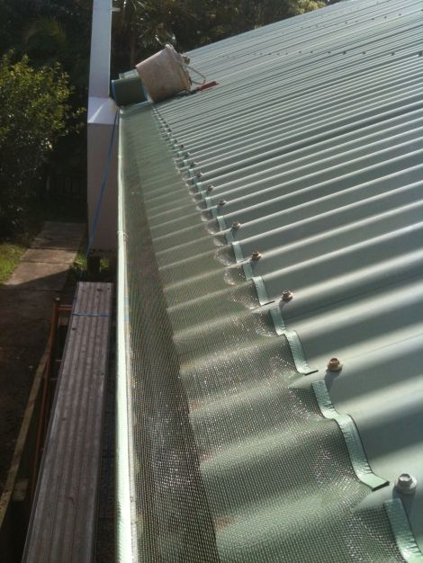 Leaf Free Gutter Guard On Metal Roof Facade House House