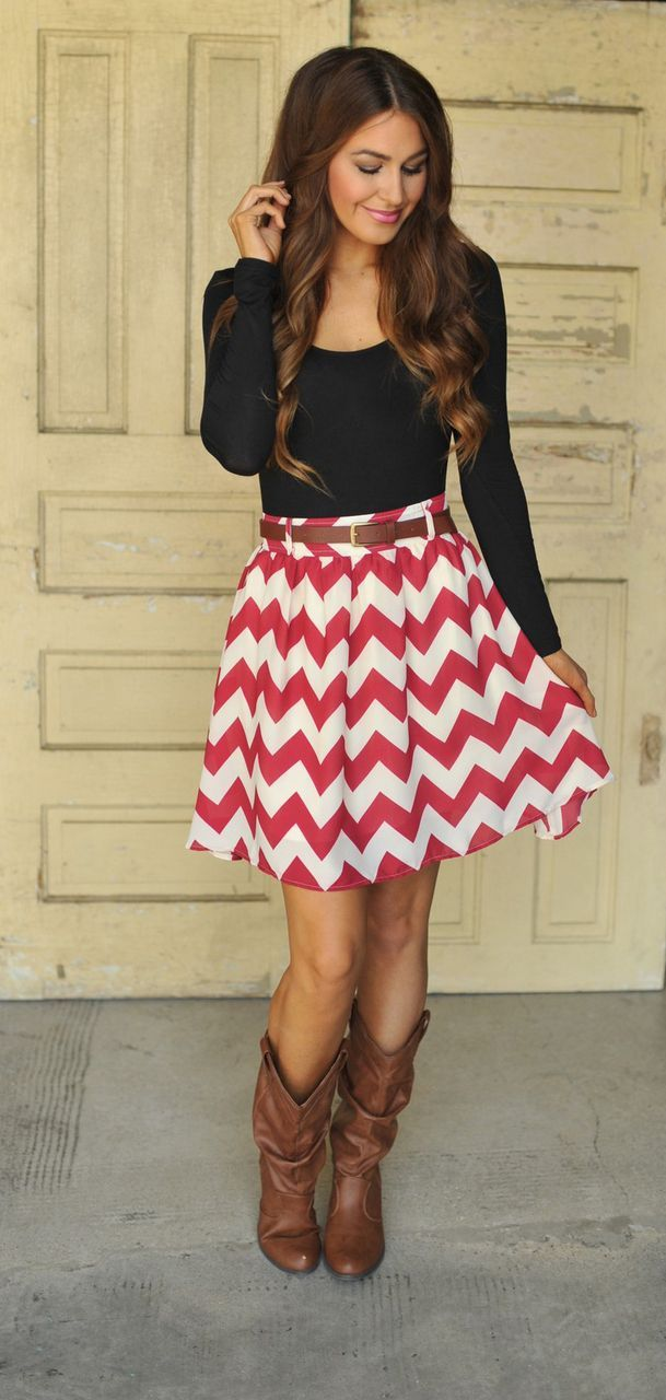 This combination of a black long sleeve t-shirt and a red and white herringbone skater skirt is perfect for off-duty occasions. Brown leather knee high boots will add elegance to an otherwise simple look.  Shop this look for $52:  http://lookastic.com/women/looks/black-long-sleeve-t-shirt-brown-belt-brown-knee-high-boots-red-and-white-skater-skirt/4180  — Black Long Sleeve T-shirt  — Brown Leather Belt  — Brown Leather Knee High Boots  — Red and White Herringbone Skater Skirt