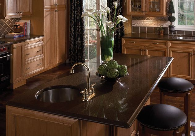 Silestone traditional kitchen coffee brown like this for Brown kitchen cabinets with black granite