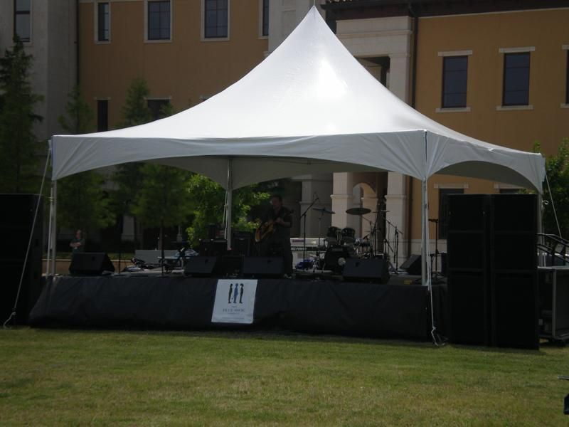 Outdoor event with staging and tent rental. | Frame Tents ...