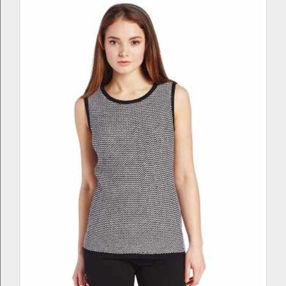 Calvin Klein Women's Chevron Stitch Shell Sweater Solid trim frames the zigzagging knit of a simple sleeveless shell in always-versatile black and white. - 55% cotton, 45% acrylic - Hand wash cold, lay flat to dry Calvin Klein Tops