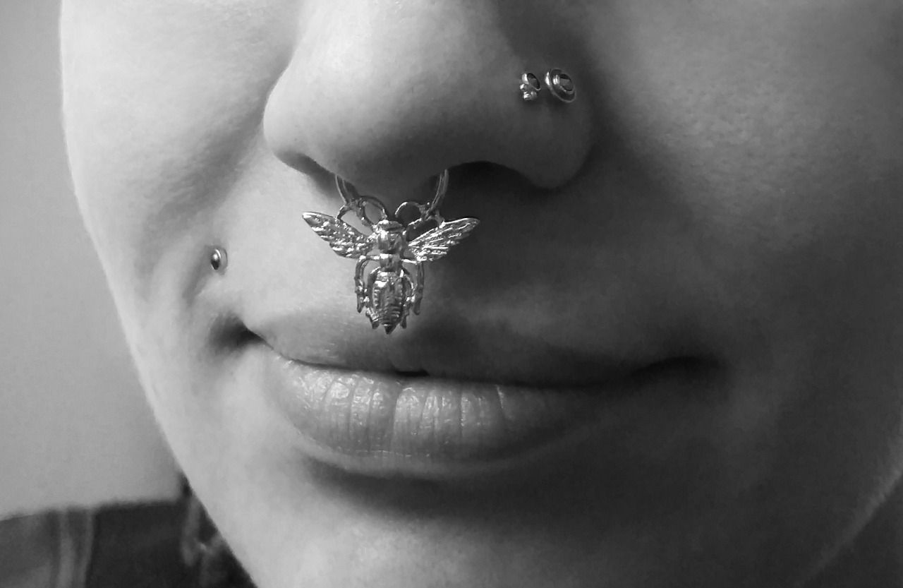 Piercing between nose and lip  Took awhile to find a photo of somebody wearing this piece Silver
