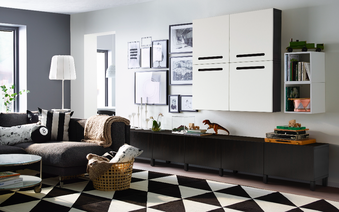 A Large Livingroom With Black Brown Low Storage With Drawers And  Black Brown Wall Cabinets With White Doors. Shown Together With A Dark Grey  Two Seat Sofa ...