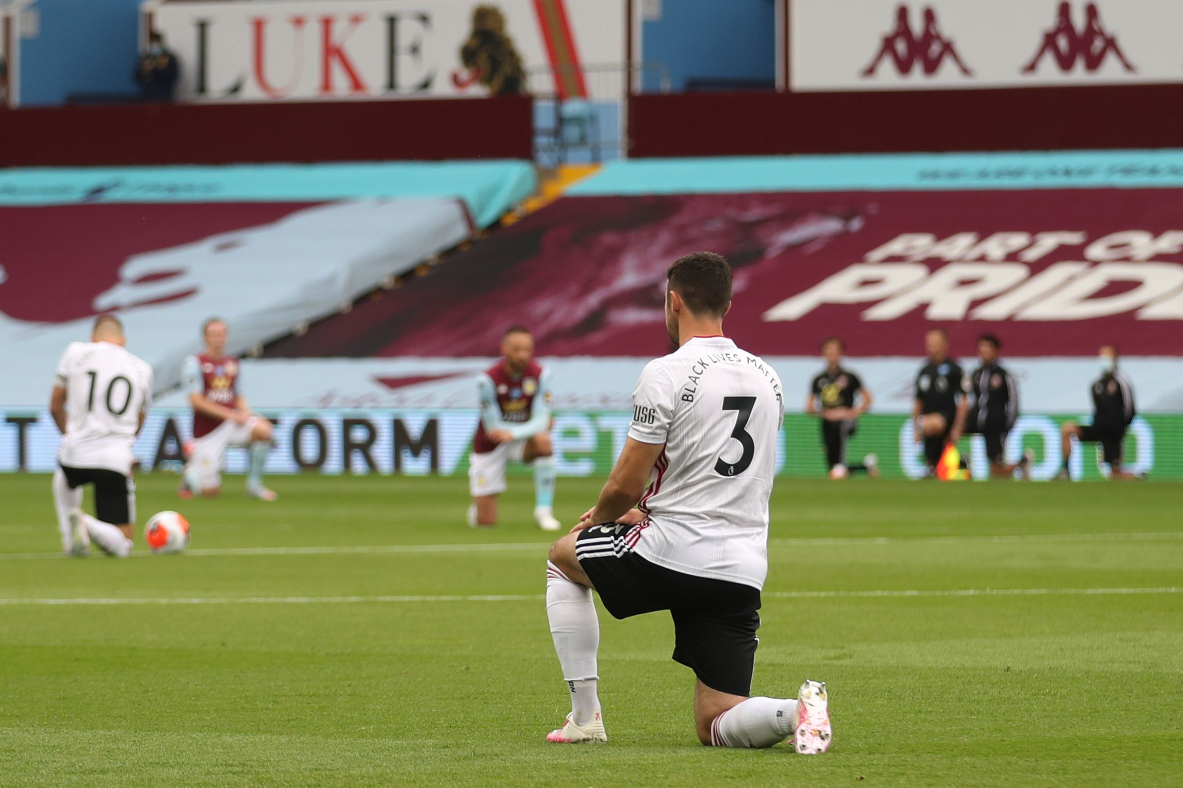 Sheffield United's Irish defender Enda Stevens kneels