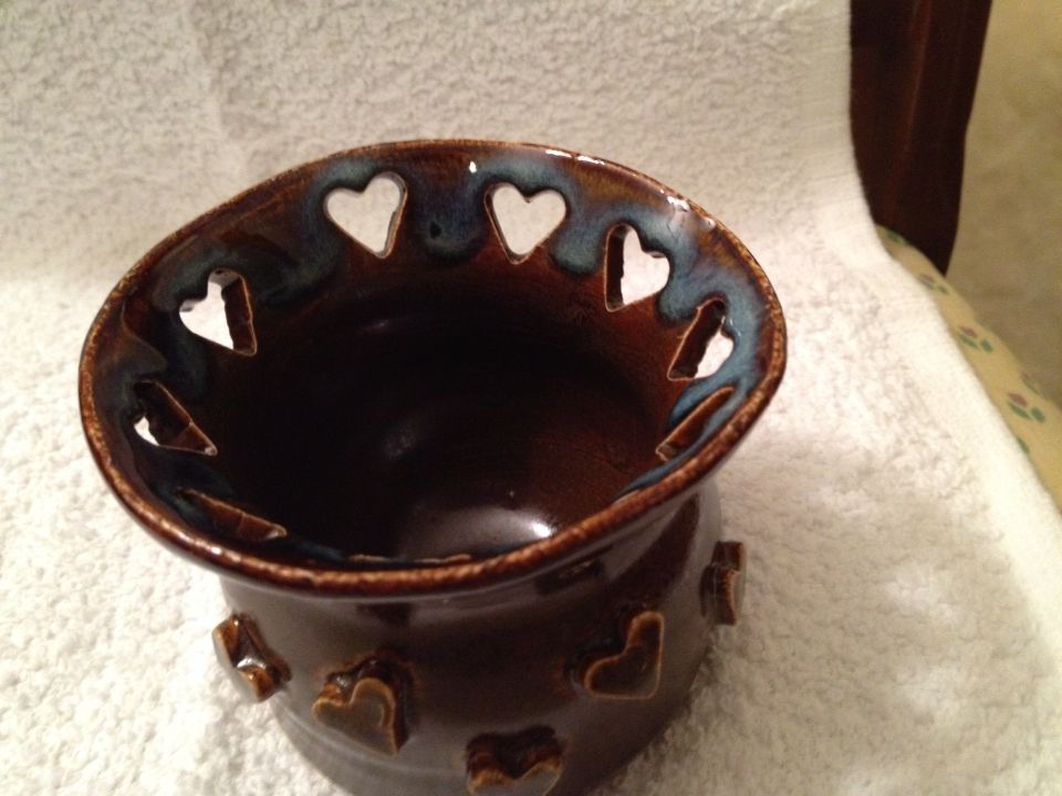 Candle holder with heart cutouts.
