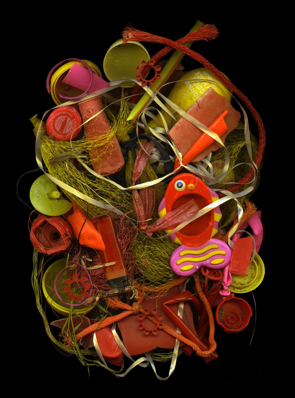 yellow orange red:   Plastic and ribbon collected at Ocean Beach. Pigment print on etching paper,   22x29.5 inches    29x39.5 inches or larger ()