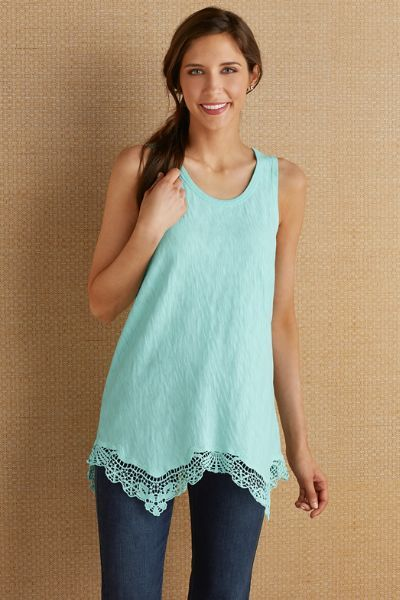 "A sweet flourish of crochet at the hem turns this everyday tank into a special treat. Soft slubbed knit drapes to a double-dipped hemline in front and back. Ribbed binding at neckline. Cotton. Misses 26""/30"" long. Crochet Trim Tee #2AP64"