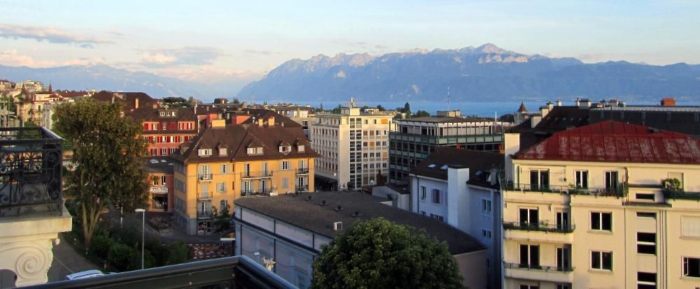 Lausanne, Switzerland... Across the lake on the French side rise the Savoy Alps.