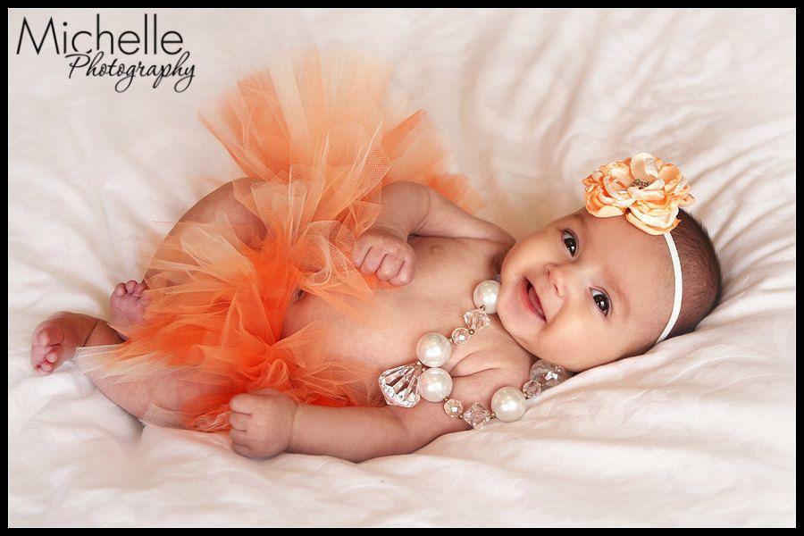 Newborn Infant Baby Girl Tutu with Matching Flower Headband, Peaches N' Cream, Photo Prop, Birth Announcement. $29.50, via Etsy.